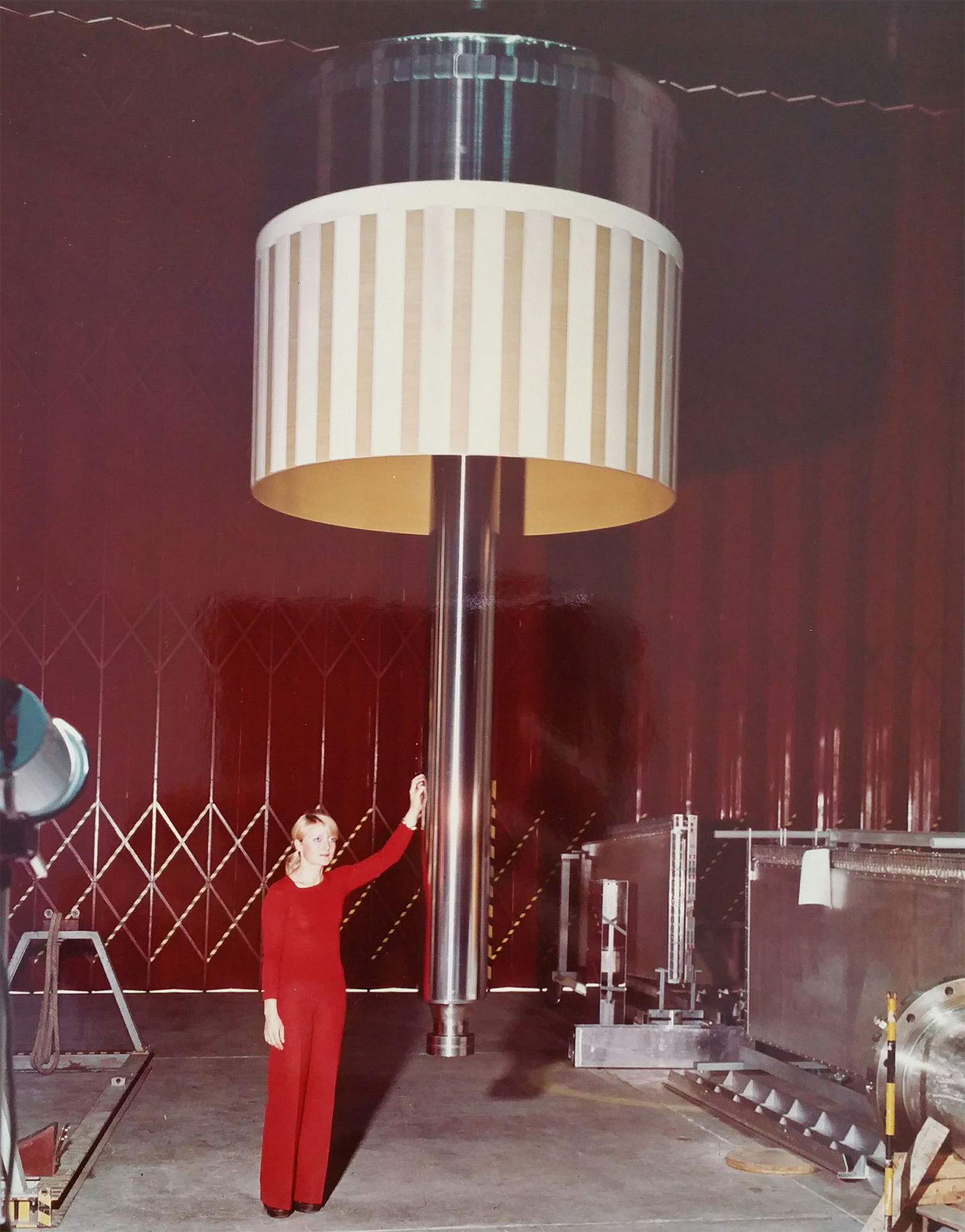 A lady from CERN standing next to a piston used in BEBC